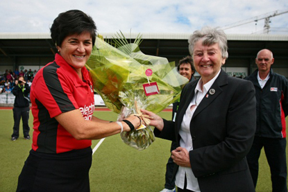 Marelize de Klerk receives flowers from FIH Executive Board Member Anne Ellis