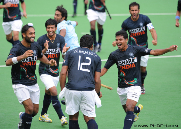 The India team erupts after the winning goal against Malaysia is scored