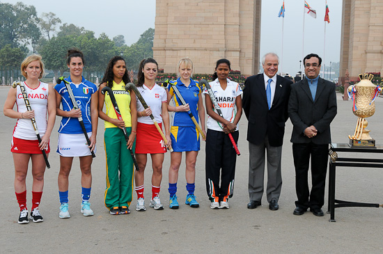 Women's teams Captains with Leandro Negre (FIH President) and Mr. Ajay Maken, Indian Minister of Youth Affairs and Sports