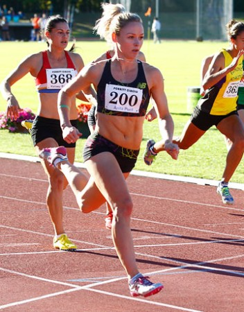 Track star: Black Stick and sprinter Anita Punt, foreground, turns on the speed in the 100m at Porritt Stadium in Hamilton on Saturday.