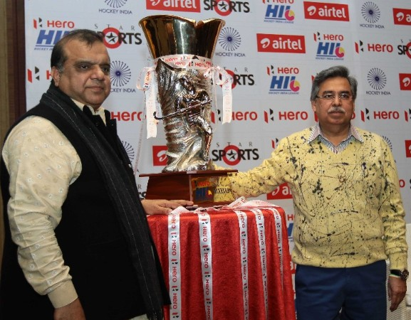 Dr. Narinder Batra, Hockey India Secretary General & Chairman Of Hero Hockey India League, & Mr Pawan Munjal, CEO of Hero MotoCorp Ltd with the Hero Hockey India League Trophy