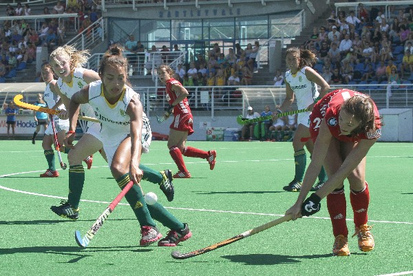 Belgium's Judith Vandermeiren gets the ball away as Quanita Bobbs of South Africa comes in to challenge during the fourth Test at Hartleyvale Stadium in Cape Town Saturday.