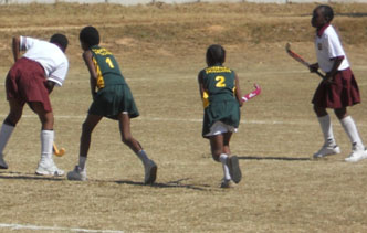A group of school children playing hockey in Zimbabwe
