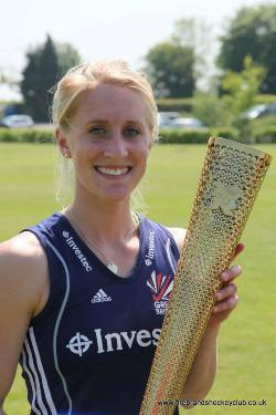 Susie Gilbert holds the Olympic Torch