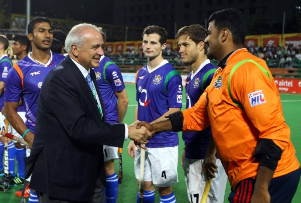 FIH President Leandro Negre greets the players of Uttar Pradesh Wizards ahead of their 1-0 win against Dabur Mumbai Magicians on Tuesday.